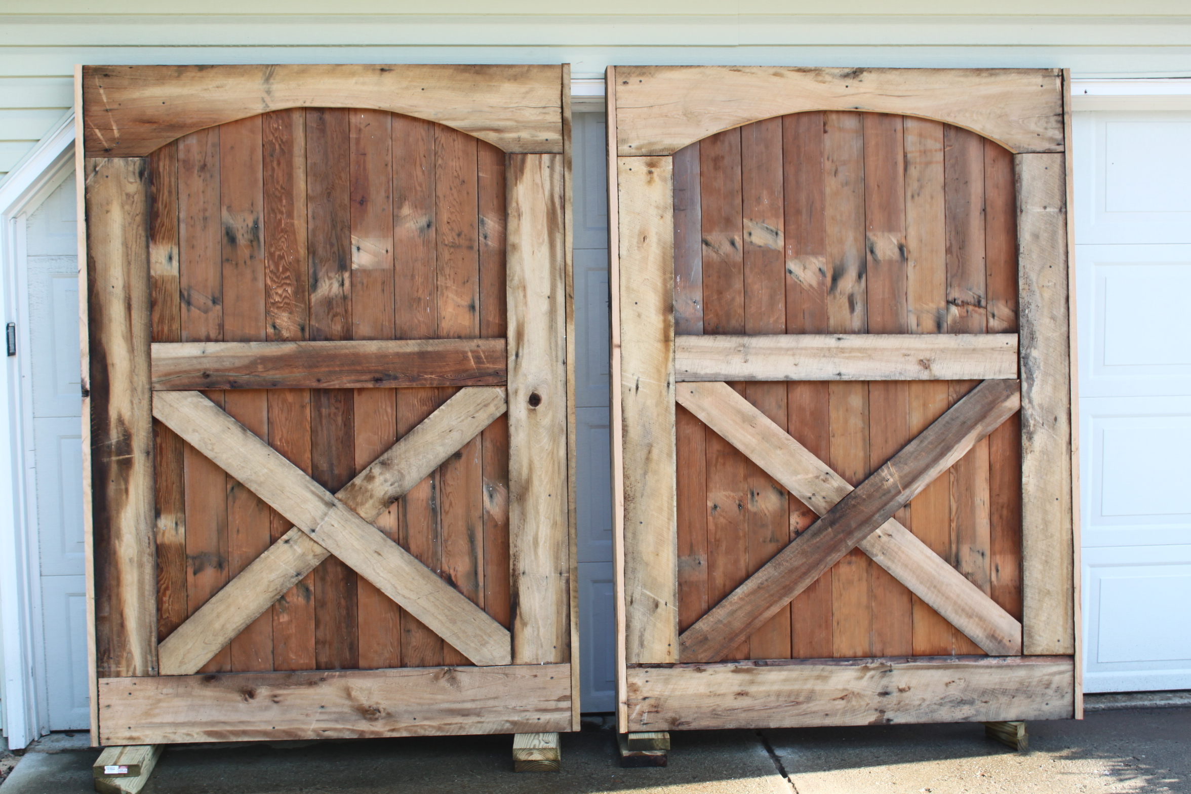 Barn doors are up we have closure old world garden farms - How to install an exterior sliding barn door ...