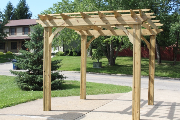 Early summer 2011 - the farms first pergola is built in the driveway and then hauled to the farm.