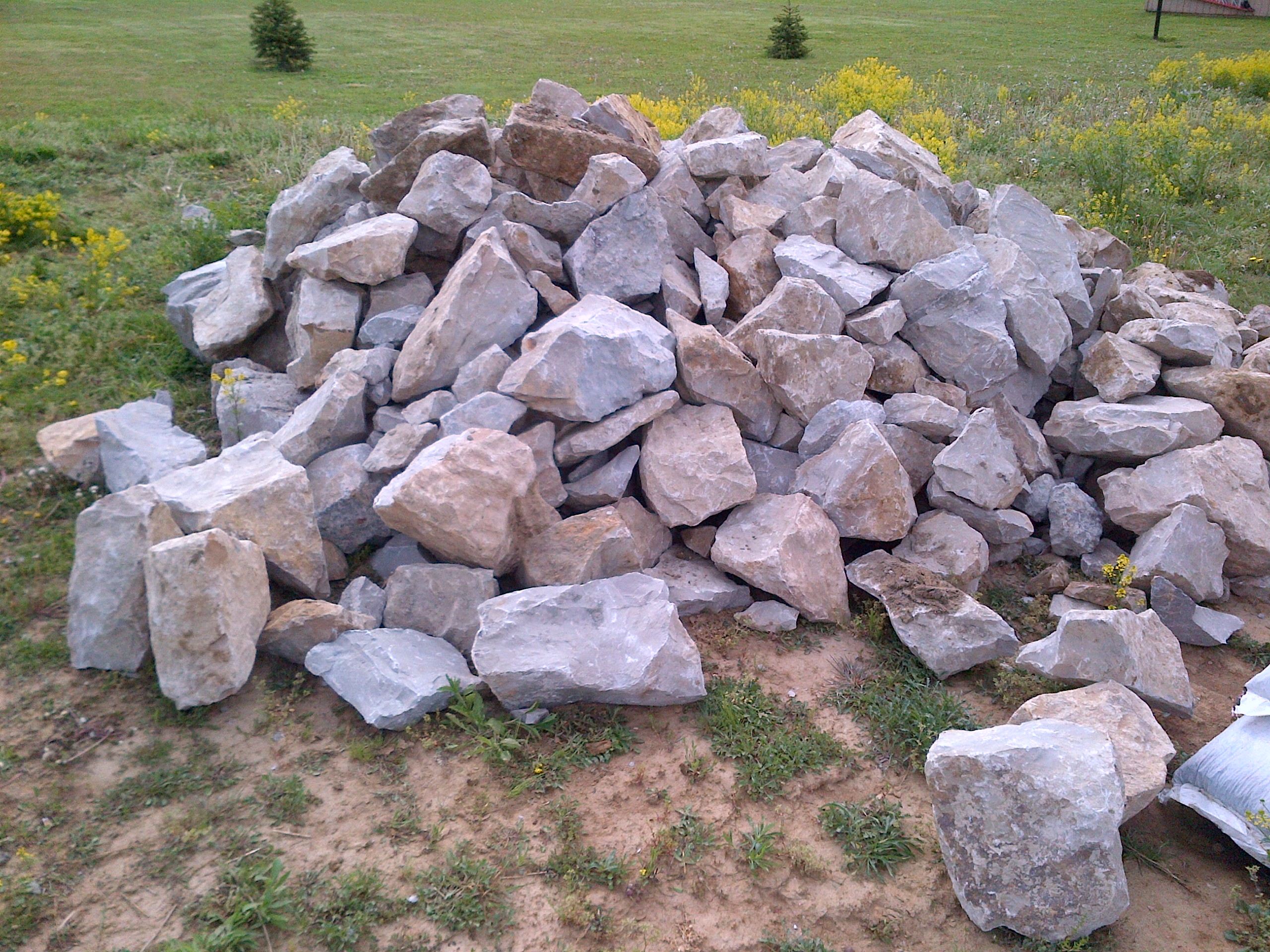 Moving 20 ton of rock and boulders in place old world for Landscaping rocks by the ton