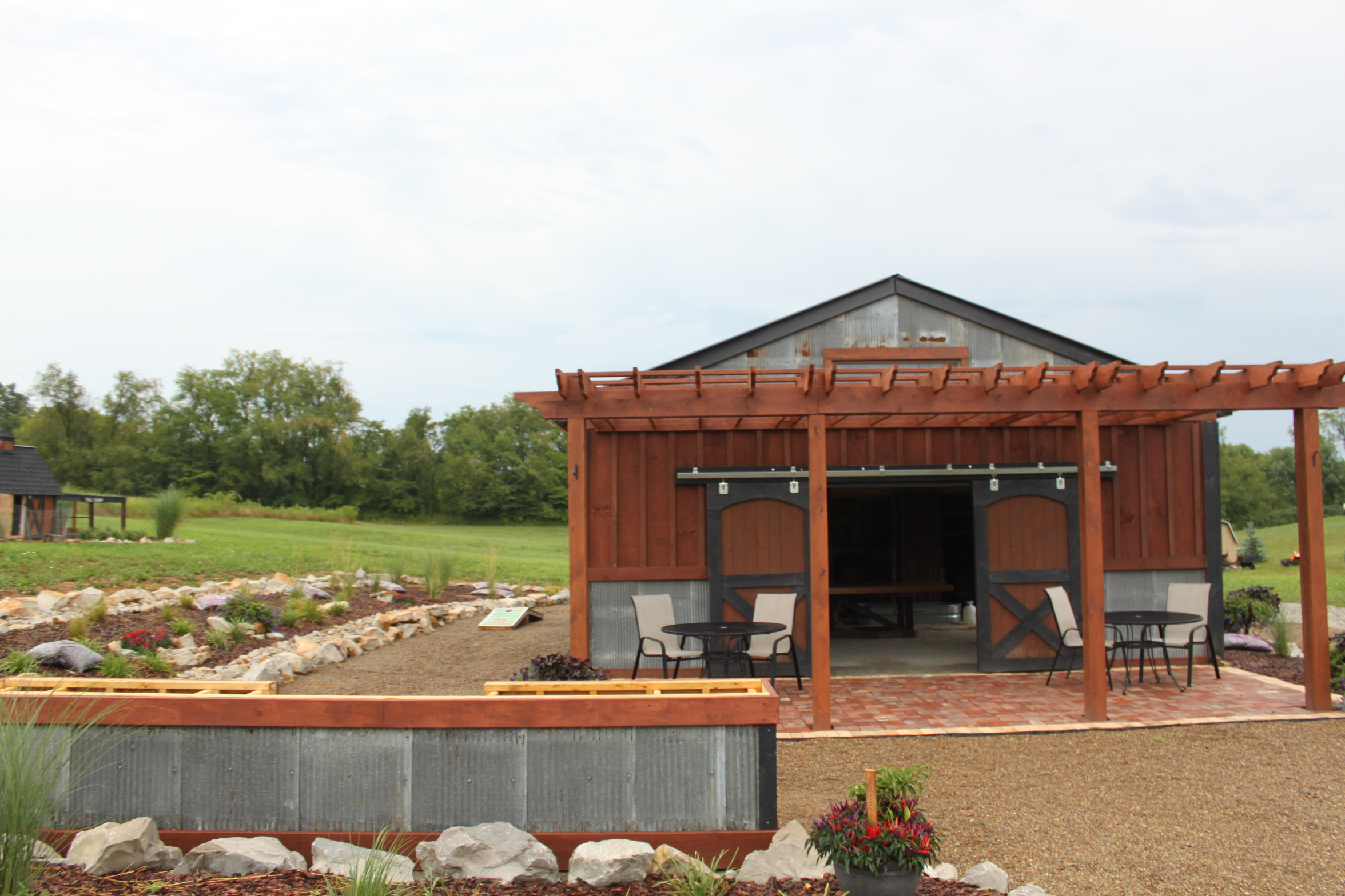 Outdoor summer barn kitchen completed old world garden farms for Barn house kitchen ideas