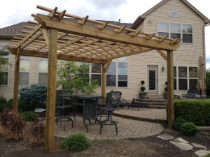 One of our 16 x 16 pergolas erected around a patio.