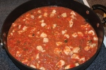 Sauce and chicken simmering in the skillet.