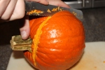 Using a serrated knife to cut the exterior of the pumpkin is the easier and safest way to cut a pumpkin, besides an electric knife.