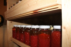 Canned tomato juice in our canning cabinet