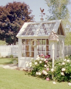 This greenhouse  made from recycled windows will be our model for building ours