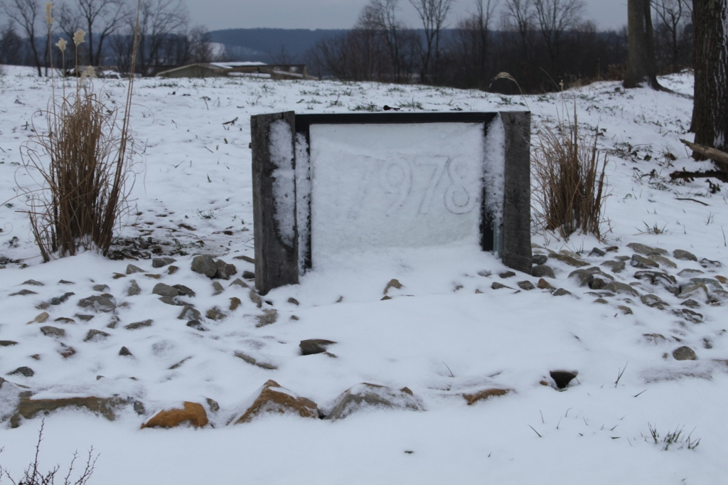 A little hard to read the old barn window address sign in the winter snow