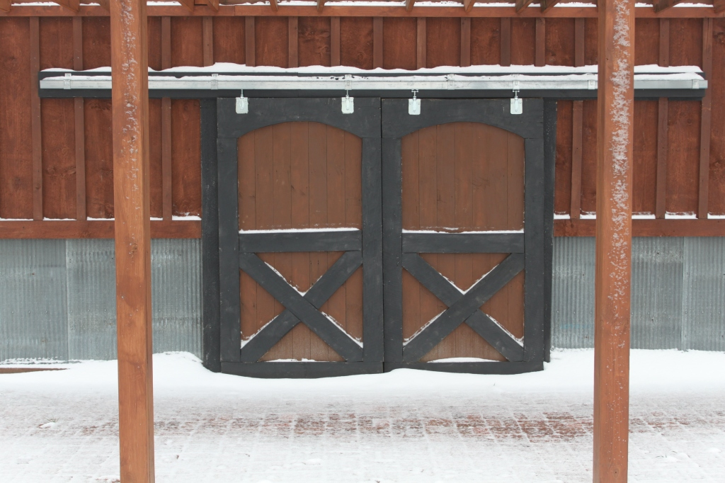 The barn doors leading inside from the barn pergola patio.