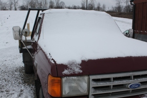 Ol Betsy the farm truck looks a little cold with her blanket of snow..she won't be going anywhere for awhile.