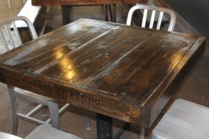 """All in all - we built 10 36 x 36"""" table tops and a huge 12' farm table for seating at the pub."""