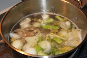 Ingredients simmering in a large stock pot