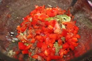 Ingredients ready to be mixed for a more appealing guacamole