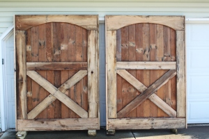 One of our first recaimed projects -the building of our barn doors from old barn flooring