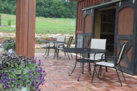 Our finished barn patio and pergola - built mostly from recycled materials (furniture included!)