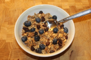 It doesn't get any better or healthier than homemade granola cereal with fresh blueberries and raisins.