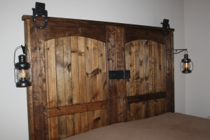 "Our completed ""new"" old barn door headboard"