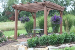 We will a pergola garden structure to the center of the garden, matching  the style of our garden pergola but with some added touches like a gabled rood and reclaimed window walls