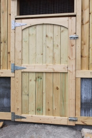 "We made the door from some 2 x 6's, fence picket boards, and a 1/2"" sheet of plywood"