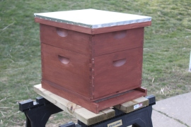The bee hive after getting a second of 3 coats of stain.