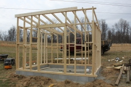 The coop was framed in 2 x4's - on top of a concrete block foundation secured with concrete and bolts