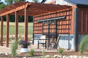 Our barn pergola - a favorite spot at the farm to sit and relax
