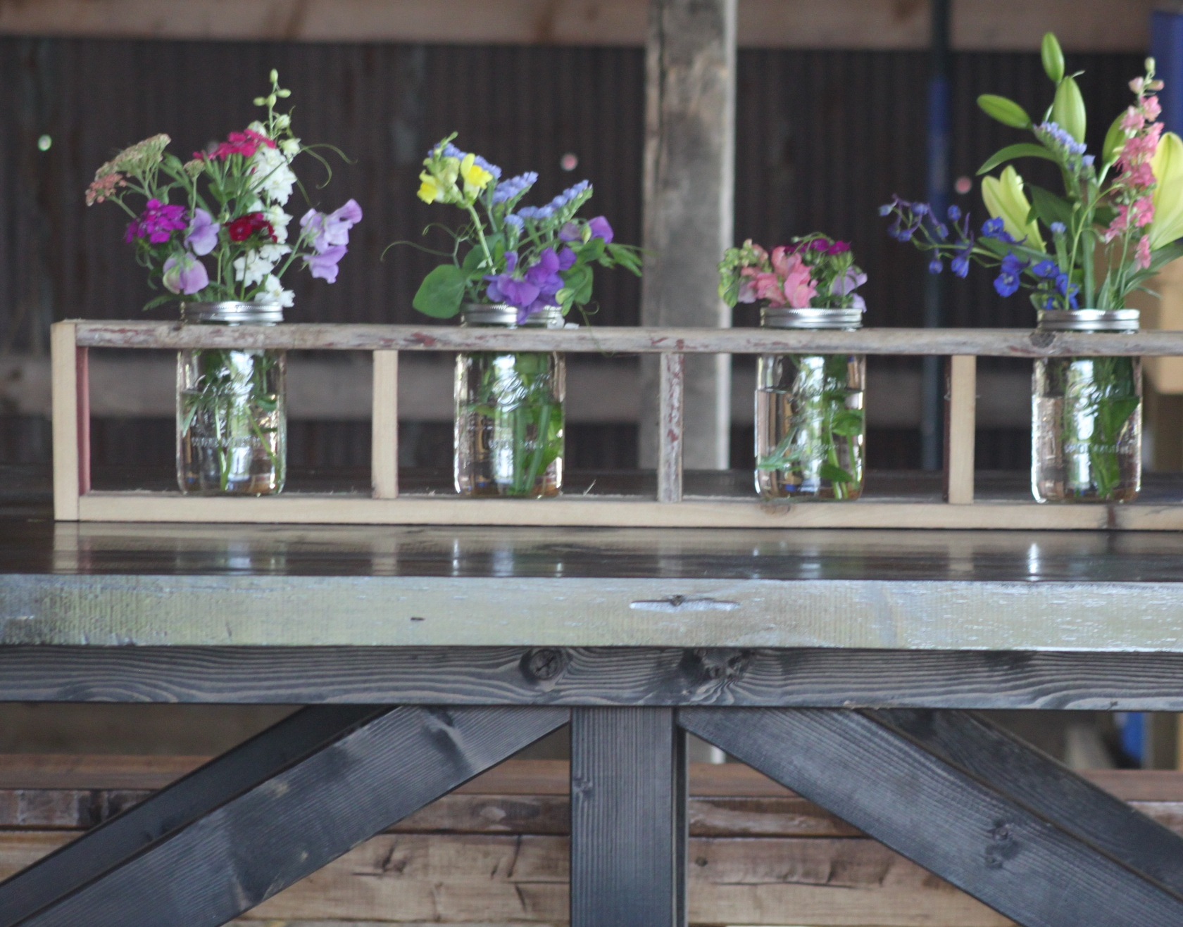 Creating a mason jar centerpiece from old barn wood or