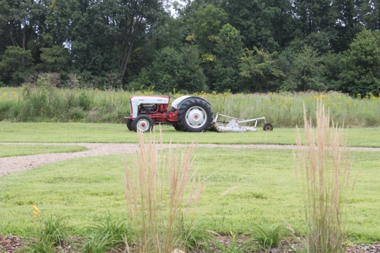 "Our ol' Ford Tractor ""Willie"" takes a rest after working hard to mow the property"