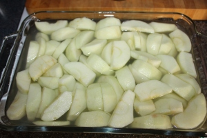 Apples peeled, cored and sliced dipped in lemon juice and water to prevent browning.