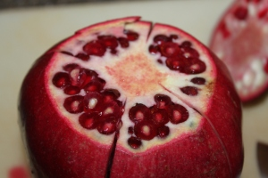 After you cut the top of the pomegranate, score each section which is easily seen.