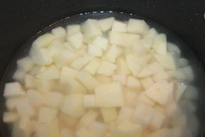 Dice potatoes in consistently sized pieces to allow for even cooking.