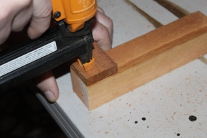 We started by stapling a slat piece flush with each end of a corner piece