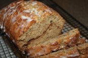 Banana bread with a cinnamon sugar layer in the middle - topped with a simple glaze.