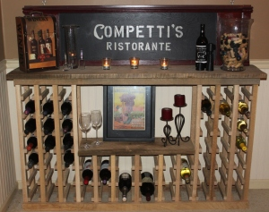 The wine rack holds 54 standard bottles and 6 large magnum bottles