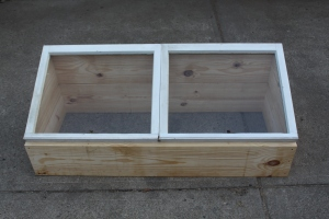 You can attach windows with a few simple hinges - or a wood frame with a plastic top to cover your cold frame.