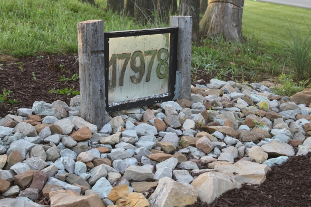 The old window we converted into our front address sign