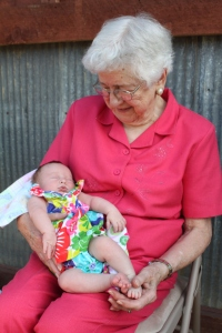 My mom proudly holding one of her many great-grandchildren