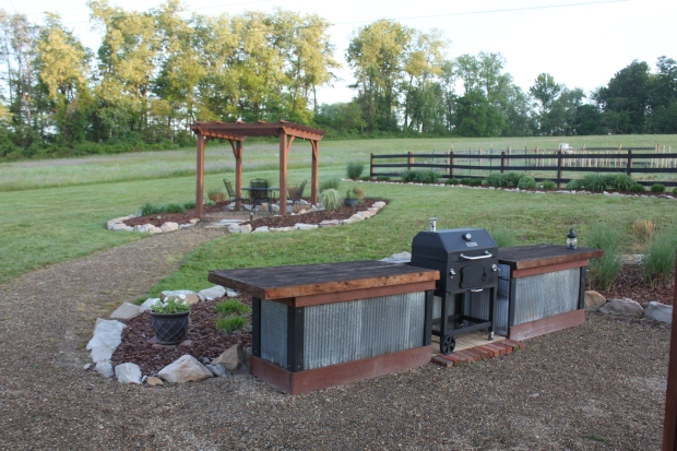 One of our other favorite spots - the outdoor kitchen and upper pergola area