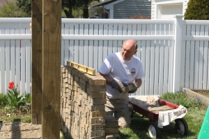 My brother-in-law gets the brick ready for the patio