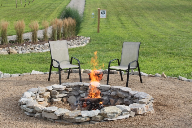 One of our favorite new places to sit - the completed fire pit area!