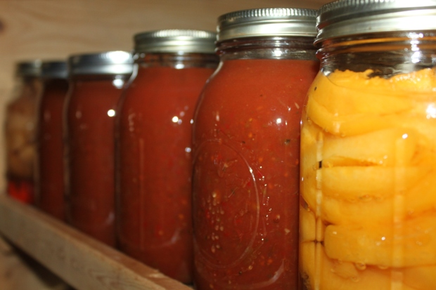 The best part of fall - the canning cabinet is stocked for winter!