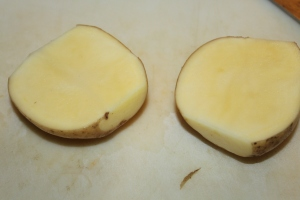 Cut your potatoes in half lengthwise and then again before slicing your fries.