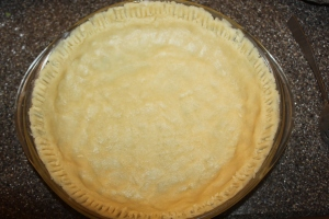 The crust is pressed down into the pie plate with your fingers - no rolling pin needed!