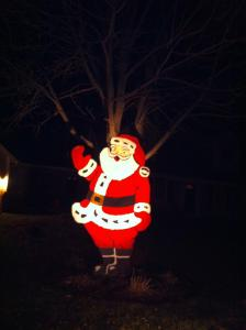 Santa lit up at night at my sister's house - where he spent the last few years