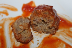 Pork and Beef meatball made with sauerkraut and barbecue sauce.