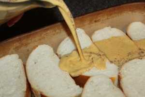 Layer bread in the pan and pour egg mixture over the bread to soak it.