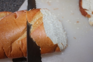 Slice the bread on an angle to give you enough surface area to cover the mouth of your bowl.