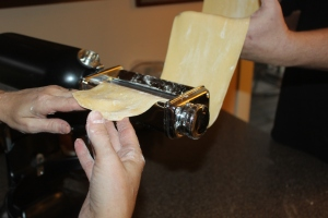 Roll dough through a pasta maker several times to make lasagna noodles