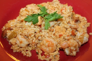 Combine the jambalaya with the rice and garnish with parsley.