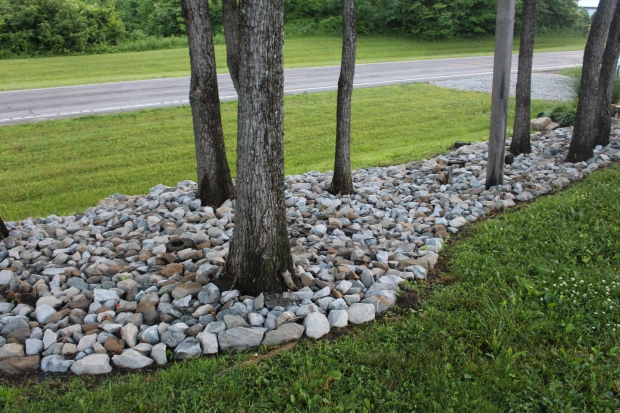 We added rock to the front entrance hillside to stop any erosion, and to keep it easy to maintain