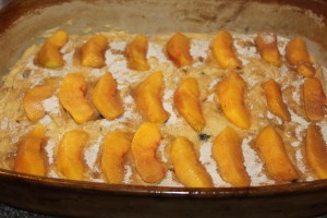 Add sliced peaches on top of the final layer of batter